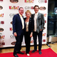 Lynda Brown, KidsEat! founder, poses on the red carpet entryway for a photo with Don and Dan McKean. (Travis Barton/City Journals)