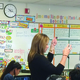 Johanna McMullin walks through her class checking on group tables to address questions. (Aspen Perry/City Journals)