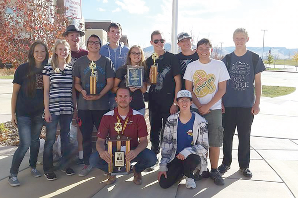Herriman High School Band students and their director, Brandon Larsen, pose for a photo after winning the Red Rocks UMEA State Championships in St. George on Oct. 28. (Herriman High School Band)