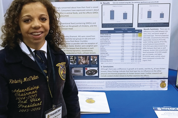 Kimberly McClellan, 18, stands next to her poster about the effects of organic and conventional feed on the physical properties of chicken at the Future Farmers of America National Convention and Expo in Indianapolis. McClellan was one of 15 students from the nation selected to participate at the convention in her division. (JoLyn McClellan)