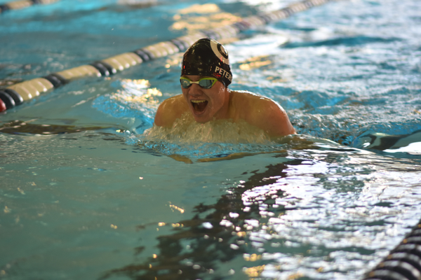 Senior Connor Peterson competes in the 200-yard individual medley on Nov. 4 at the Stein Youth Aquatic Club. (Cindy Nordstrom/Highland swim team)