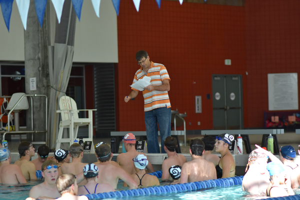 Head coach Mark Gray gives instructions to the team during a preseason practice. (Cindy Nordstrom/Highland swim team)