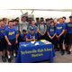 The Taylorsville Warriors baseball team surrounds Crosby Bringhurst, one of their right-handed pitchers, to celebrate his signing of a letter of intent to play at the University of Kentucky. (Tori La Rue/City Journals)