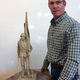"""Dan Snarr stands by the model he made prior to creating """"Proud,"""" a 12-foot bronze sculpture. The original """"Proud"""" statue was placed in Garden City, Utah, and Snarr hopes to bring a second casting to the Veterans Memorial Park in West Jordan."""