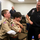 A West Jordan Fire Department engineer helps two Boy Scouts learn the correct way to perform the Heimlich maneuver on a person who is choking at a merit badge class on Nov. 8. The department started offering four types of merit badge class in October. (Tori La Rue/City Journals)