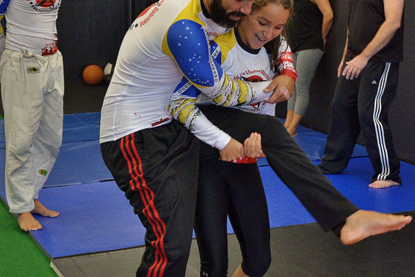 "Celio ""Ty"" Silva demonstrates an escape move with daughter Kalina"