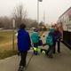 Karen  Mrs. Oliver helps students load up skis ounto the tour bus. (Rubina Halwani/City Journals)