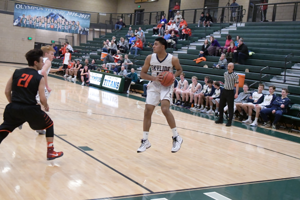 Nifai Tonga, junior small forward, catches a pass against Park City on Dec. 28 at Olympus High School. (mylocalradio.com)