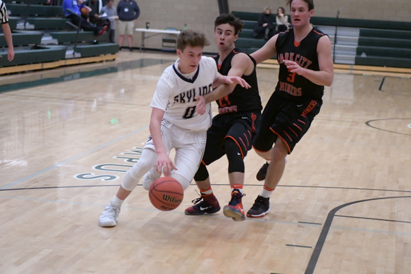 Michael Vorwaller, senior shooting guard, drives to the basket against Park City on Dec. 28 at Olympus High School. (mylocalradio.com)