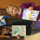 Altara students Chelsea Perez Rio and Giselle Sullivan won the school's idle-free art contest. Their artwork will be displayed on a vinyl sign that will be displayed outside the school. (Cindy Boyer/Altara Elementary PTA)