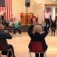 Alexandra Bradshaw teaches a dance class to seniors in Colorado while on tour with the company. (Ririe-Woodbury Dance Company/ Stuart Rickman).
