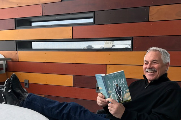 "Salt Lake Library Director Jim Cooper reads ""A Man Called Ove,"" the book for the first United We Read. (Liz Sollis/Salt Lake County Library Services)"