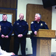 New Murray city police officers Steven Jennings and William Riding stand with Police Chief Craig Burnett before they are sworn in at the Dec. 13 city council meeting. (Mandy Ditto/City Journals)