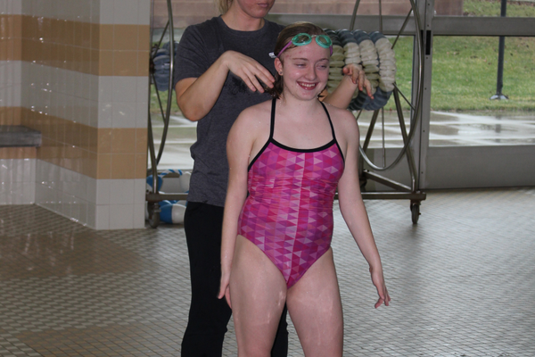 Ivy Hausknecht, who spearheads the adaptive swim programs for Salt Lake County, works on the backstroke technique for Maya, who is all smiles. (Travis Barton/City Journals)