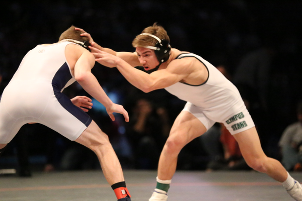 Sophomore Isaac Wilcox battles Holland Knudsen of Timpanogos in the state championship match. Wilcox won 17-2 to claim the state title. (Macy Wilcox)