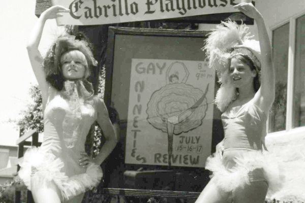 "Showgirls promote the ""Gay Nineties Review"" in front of the new theatre."