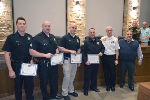 Officer Damien Olson, Officer Gary Young, Officer Kevin Salmon and Officer Demitri Shirts receive their Lifesaving Challenge Coin for their efforts in the Push to Survive program. (Dan Metcalf/Cottonwood Heights)