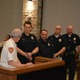 Assistant Fire Chief Mike Watson recognizes Cottonwood Heights Police Department officers for their job performance on a CPR call. They were nominated for an award by some of the firefighters in Cottonwood Heights. (Dan Metcalf/Cottonwood Heights)