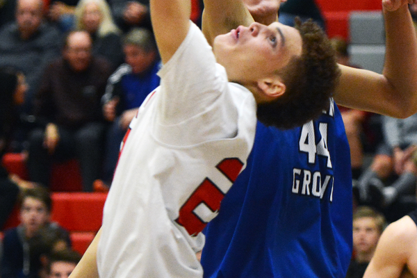 An Alta basketball player goes up for the ball in a game earlier this year. (James Falls/Alta High School)