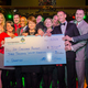 Check presentation at PSE's holiday party. Photo courtesy of Michael Leonardi, Candidly Yours Photography