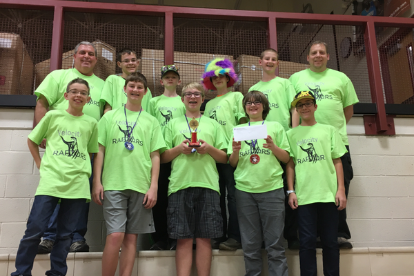 The Oquirrh Hills Middle School FIRST Robotics Competition team, the Velocity Raptors, poses with the trophy the team won at a state-qualifying event in Park City. (Todd Monson)