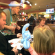 """Brinlee Sundquist, 5, stares at the cat balloon Sherman """"Reed"""" Lindholm shaped for her at the Taylorsville Applebee's. (Tori La Rue/City Journals)"""
