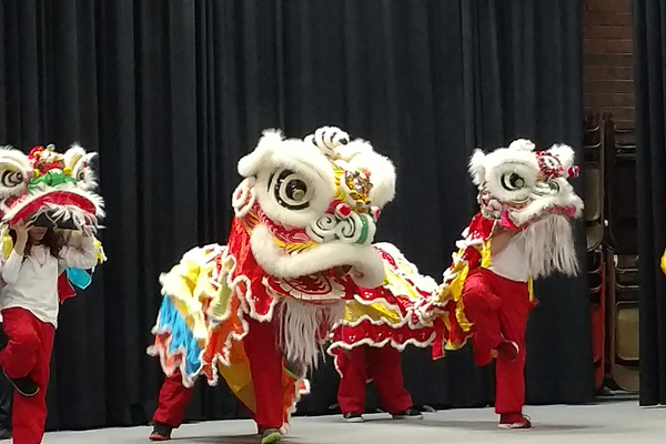 Students perform the traditional Lion Dance. (Jet Burnham/City Journals)