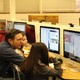 William Pettit assists students during web design lesson. (Allie Nannini/City Journals).