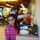 Historic Scott School teens take turns making pancakes during Friday cooking. (Aspen Perry/City Journal).