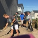 Friend-2-Friend volunteers help level the ground to lay sod at a Habitat for Humanity site. (Jen Wunderli/Friend-2-Friend)