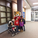 Children take photos with the tiger mascot after the festival. (Rubina Halwani/City Journals)