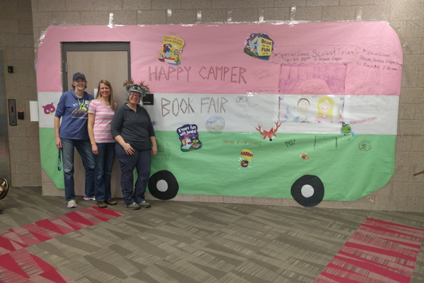 Book fair committee (from L-R): Karen Packer, Tracy Jensen and, Ily Murdock pose in front of the Happy Camper. (Ily Murdock/Butler Elementary PTA).