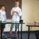 Team members presenting issues with debate cards. (eDebate Video/Olympus)