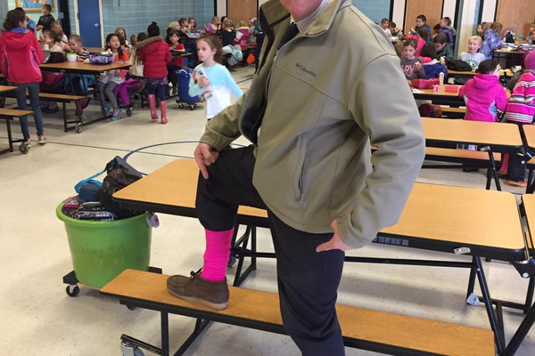Principal Michael Douglas wears bright pink socks for Crazy Sock Day. (Driggs Facebook)