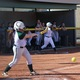 """An Olympus softball player connects with a pitch. Head coach Madison White described the team as a """"scrappy bunch who work hard."""" (Travis Barton/City Journals)"""