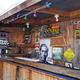 An outside bar features Juli's uncle Duke Kahanamoku.