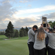The team holds the trophy aloft on the 18th green after winning the 4A state championship a year ago. (Debbie Connell/Corner Canyon girls golf)