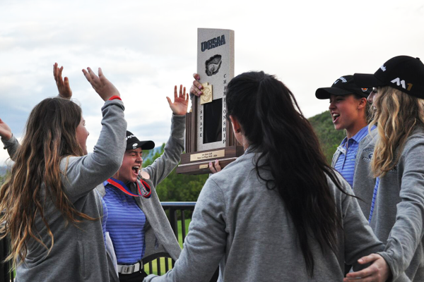 The Corner Canyon girls golf team finishes their cheer with the trophy after winning the 4A state championship a year ago. (Debbie Connell/Corner Canyon girls golf)
