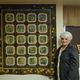 Mary Hutchings stands with one of her favorite finished works detailing aspen trees.(Keyra Kristoffersen/City Journals)