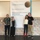 """Kyle Christensen, Brandee Hick, Taylor Dee and Eric Evans pose for a picture by the banner Verizon sent them for winning """"Best in State"""" in an app challenge. (Tori La Rue/City Journals)"""