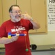 """Mont Dutson, known as """"Mont Magic"""" among his students and audiences, performs a magic trick for Salt Lake School of Magic Students at the J.L. Sorenson Recreation Center. (Tori La Rue/City Journals)"""