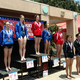 Lizzie Homes atop the podium after the AAU Red/White/Blue Nationals this past summer. (Michelle Holmes)