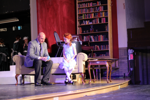 "Oliver Warbucks, played by Todd Young, and Annie, played by Elizabeth Birkner, have a heart-to-heart conversation in Riverton Art's Council's production of ""Annie."" (Tori La Rue/City Journals)"