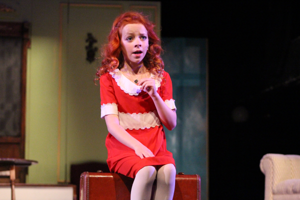 "Elizabeth Birkner, playing the part of Annie, sings a solo during Riverton Arts Council's ""Annie"" production. (Tori La Rue/City Journals)"