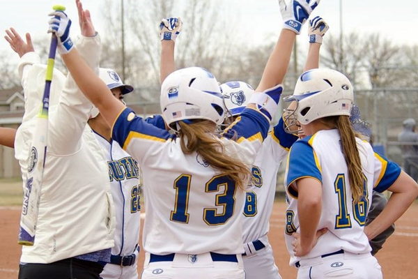The Bruins women's softball team celebrates victory over USU Eastern in its home series March 11. (Rachel Rowan/SLCC athletics)
