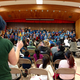 """Assistant choir director Michelle Kelly leads the school choir in a song from """"Seussical the Musical."""" (Jet Burnham/City Journals)"""