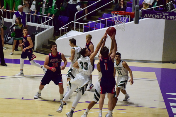 Senior Stockton Ashby goes for the block in the 4A semifinals against Springville. The Huskies only surrendered 55 points per game. (Suzanne Richins/Hillcrest Basketball)