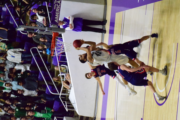 Senior John Villanueva puts up a shot in the 4A semifinals against Springville. (Suzanne Richins/Hillcrest Basketball)