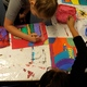 Fourth-grade students at Lincoln Elementary work on folk art for their art show on April 9. (Aspen Perry/City Journals).