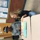 Anna McConkie helps Asumani Wilonja from Tanzania with his reading. (Elaine Toronto/ESL teacher).